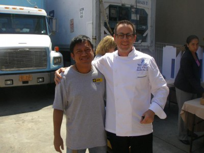 Mr. Rodon is a volunteer at Meals on Wheels, standing with Mr. Rodon is the chef from the Ritz
